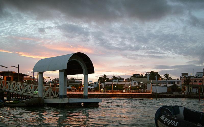 puerto ayora pier sunset galapagos ecuador